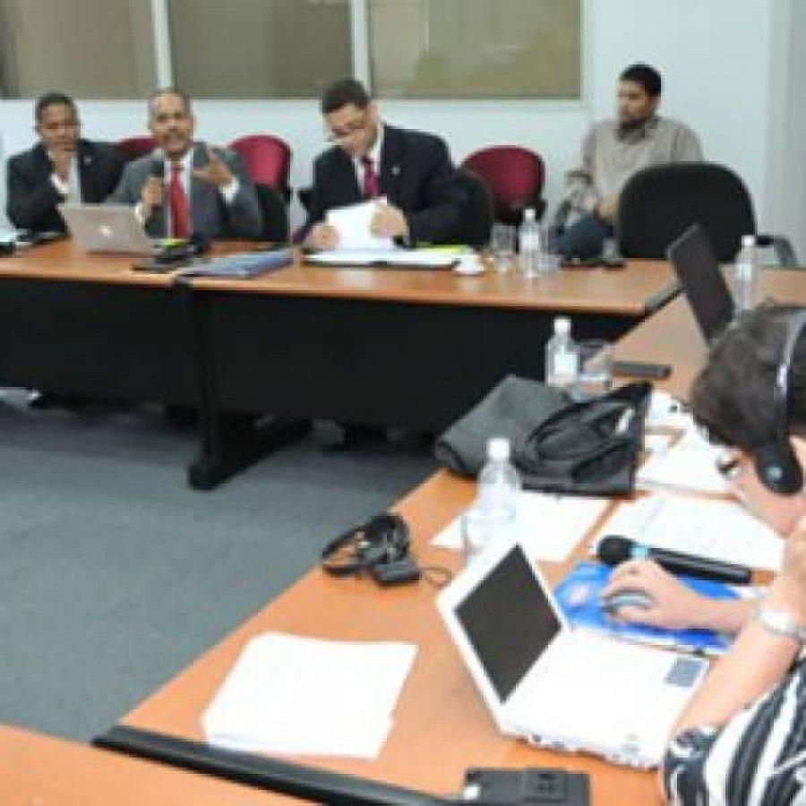 Representantes de la OEA y la OPTIC en reunión